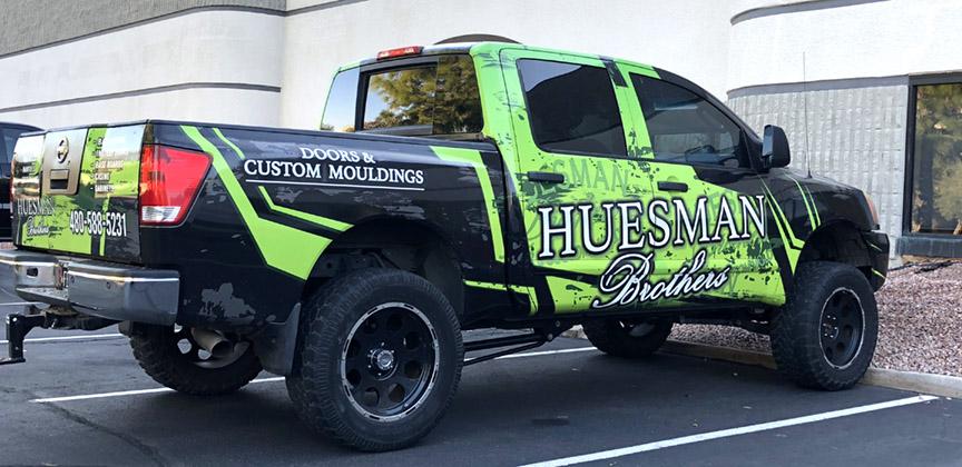 hueman-truck-vinyl-vehicle-wrap-passengers-side