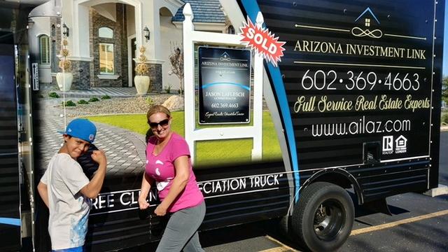 black vinyl wrapped moving truck